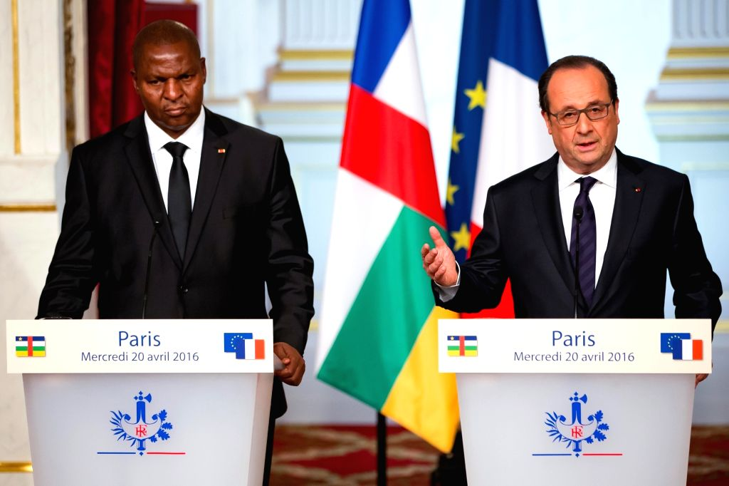 PARIS, April 20, 2016 - French President Francois Hollande (R) and visiting Central African Republic's President Faustin-Archange Touadera attend a press conference after their meeting, in Paris, ...