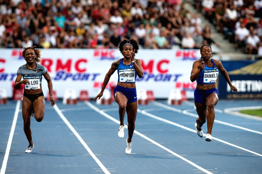 PARIS, Aug. 25, 2019 - Elaine Thompson (C) of Jamaica competes during the women's 100m final at the IAAF Diamond League in Paris, France, on Aug. 24, 2019.