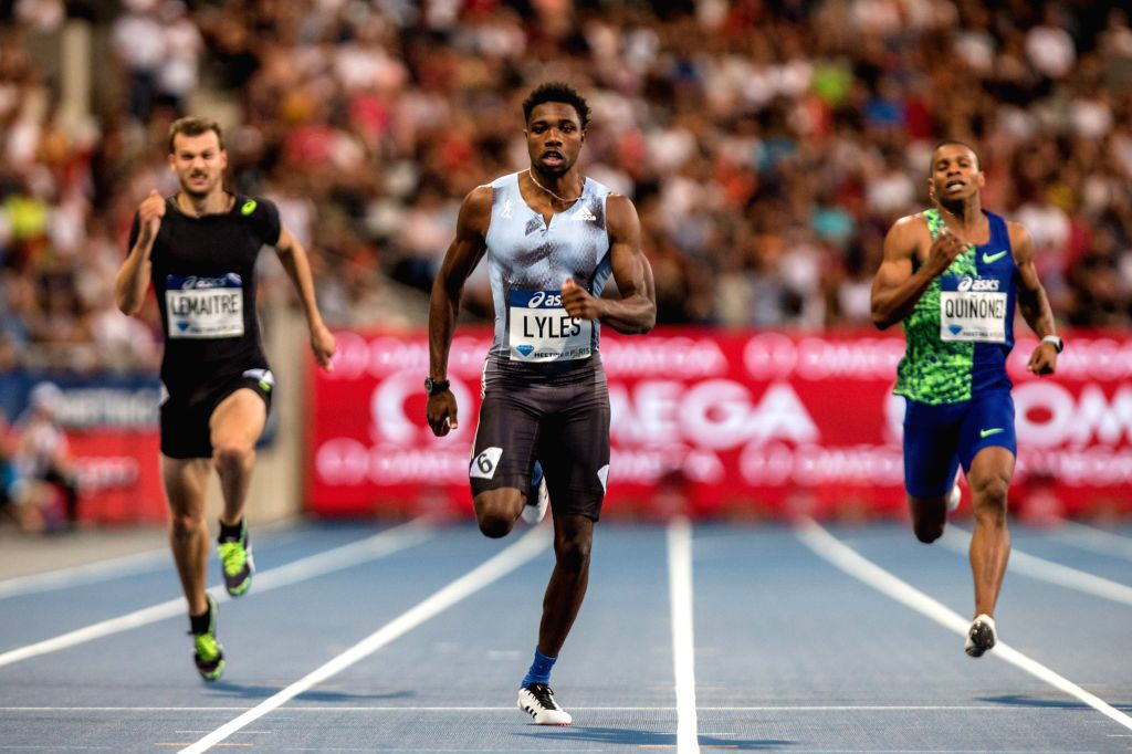 PARIS, Aug. 25, 2019 - Noah Lyles (C) of the United States crosses the finish line during the men's 200m final at the IAAF Diamond League in Paris, France, on Aug. 24, 2019.
