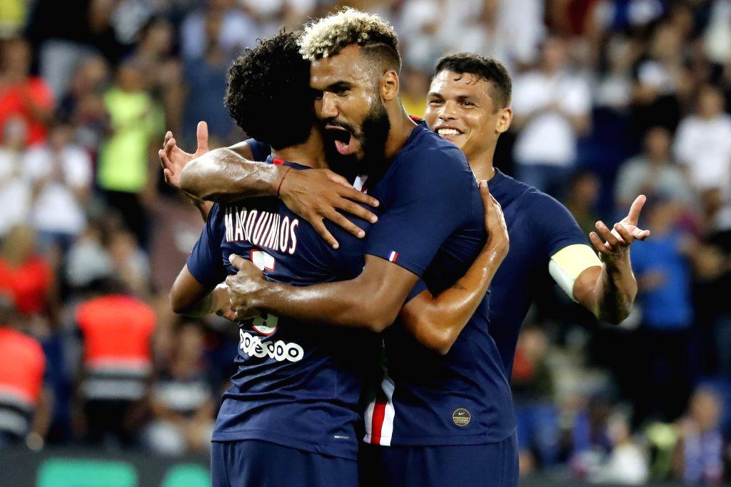 PARIS, Aug. 26, 2019 - Eric Choupo-Moting (C) of Paris Saint-Germain celebrates his goal with teammate Marquinhos during the Ligue 1 match between Paris Saint Germain and FC Toulouse at the Parc des ...