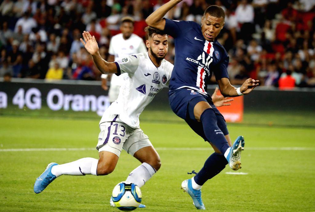 PARIS, Aug. 26, 2019 - Kylian Mbappe (R) of Paris Saint-Germain vies with Mathieu Goncalves of FC Toulouse during the Ligue 1 match between Paris Saint Germain and FC Toulouse at the Parc des Princes ...