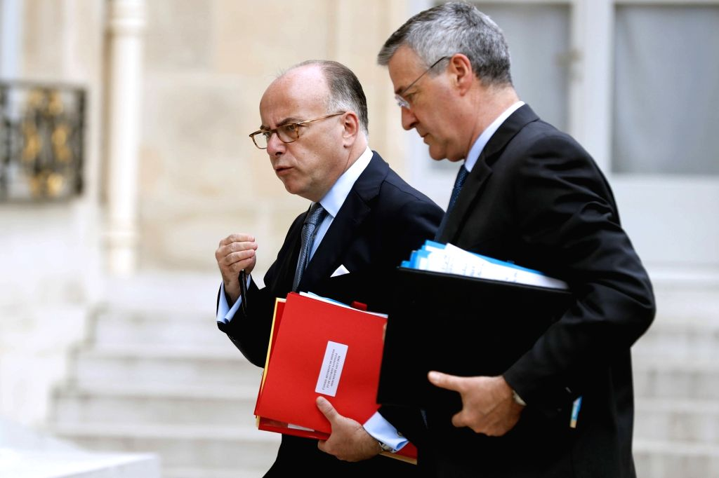 PARIS, Aug. 4, 2016 - French Interior Minister Bernard Cazeneuve (L) arrives to attend a security meeting convened by French President Francois Hollande in Paris, capital of France, on Aug. 3, 2016. - Bernard Cazeneuve
