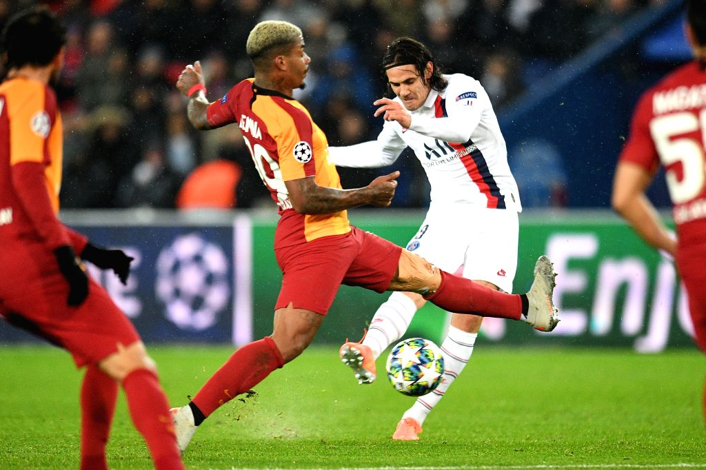 PARIS, Dec. 12, 2019 - Edinson Cavani (R) of PSG vies with Mario Lemina of Galatasaray during a Group A match of the 2019-2020 UEFA Champions League between Paris Saint-Germain (PSG) and Galatasaray ...