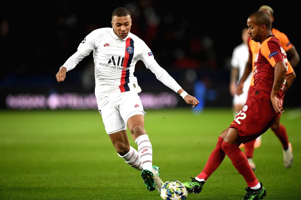 PARIS, Dec. 12, 2019 - Kylian Mbappe (L) of PSG vies with Mariano Ferreira of Galatasaray during a Group A match of the 2019-2020 UEFA Champions League between Paris Saint-Germain (PSG) and ...
