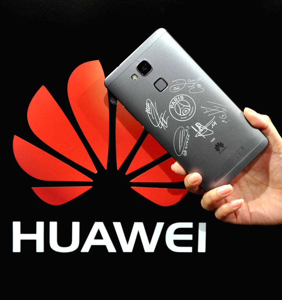 A Huawei Ascend Mate 7 smart phone of the Paris Saint-Germain (PSG) edition is displayed during the launching ceremony in Paris, France, Dec. 16, 2014. China's ...