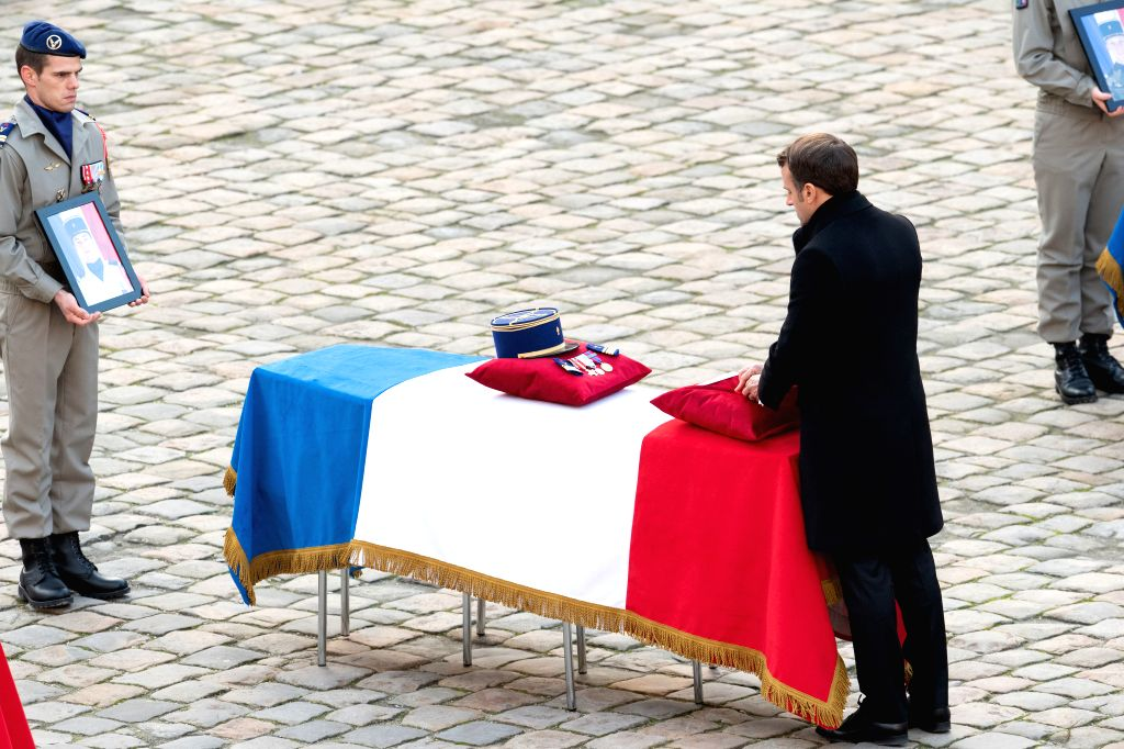 PARIS, Dec. 2, 2019 - French President Emmanuel Macron (R) attends a tribute ceremony for the fallen servicemen at the Les Invalides in Paris, France, on Dec. 2, 2019. France held the ceremony here ...