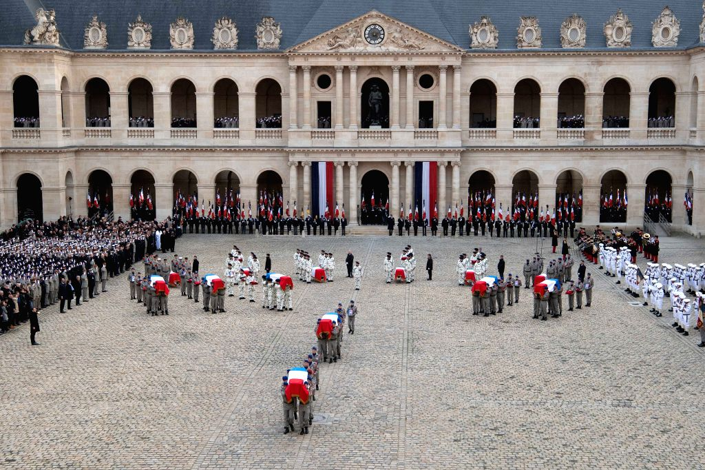 PARIS, Dec. 2, 2019 - Soldiers carry flag-draped coffins of the fallen servicemen during a tribute ceremony at the Les Invalides in Paris, France, on Dec. 2, 2019. France held the ceremony here on ...