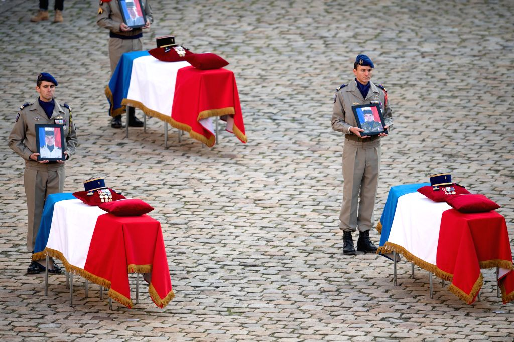 PARIS, Dec. 2, 2019 - Soldiers carry photos of the fallen servicemen during a tribute ceremony at the Les Invalides in Paris, France, on Dec. 2, 2019. France held the ceremony here on Monday to pay ...