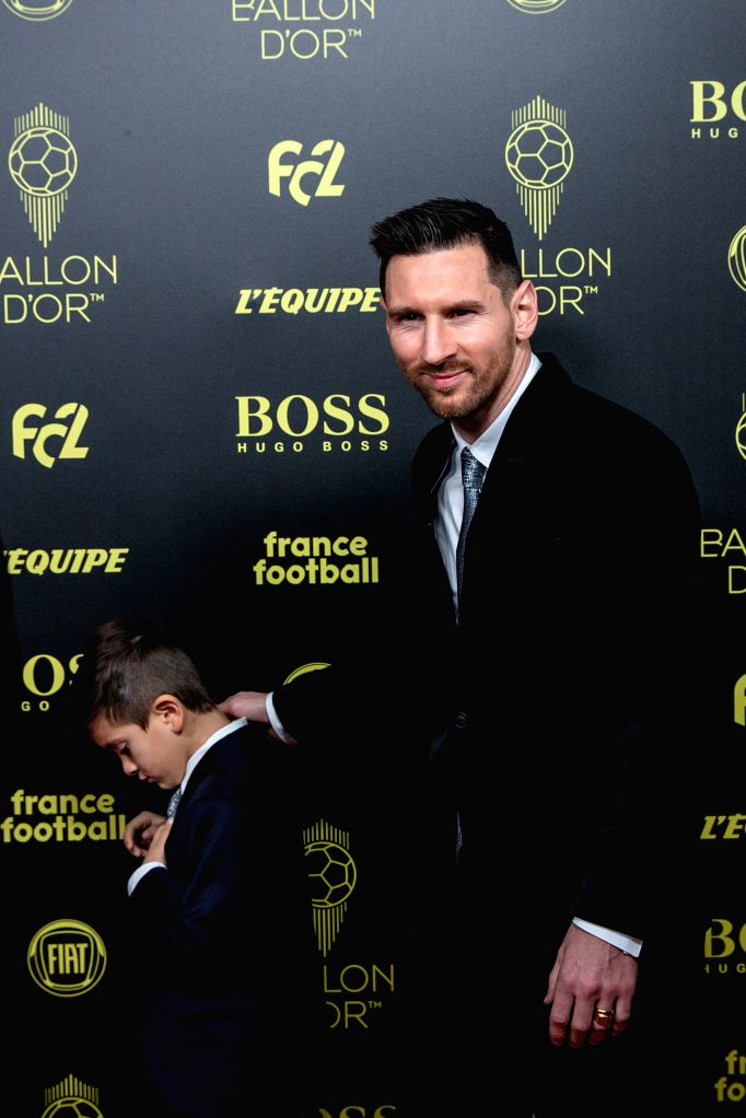 PARIS, Dec. 3, 2019 - Barcelona's Argentinian forward Lionel Messi (R) and his son arrive to attend the Ballon d'Or 2019 awards ceremony at the Theatre du Chatelet in Paris, France, Dec. 2, 2019.