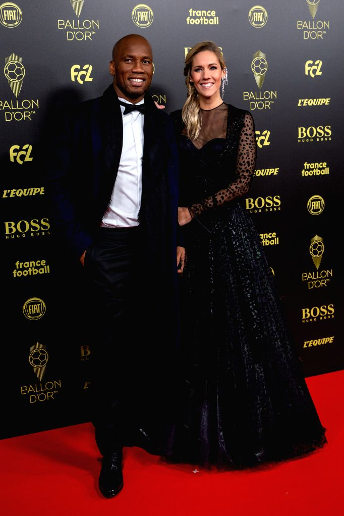 PARIS, Dec. 3, 2019 - Hosts Sandy Heribert (R) and Didier Drogba arrive to attend the Ballon d'Or 2019 awards ceremony at the Theatre du Chatelet in Paris, France, Dec. 2, 2019.
