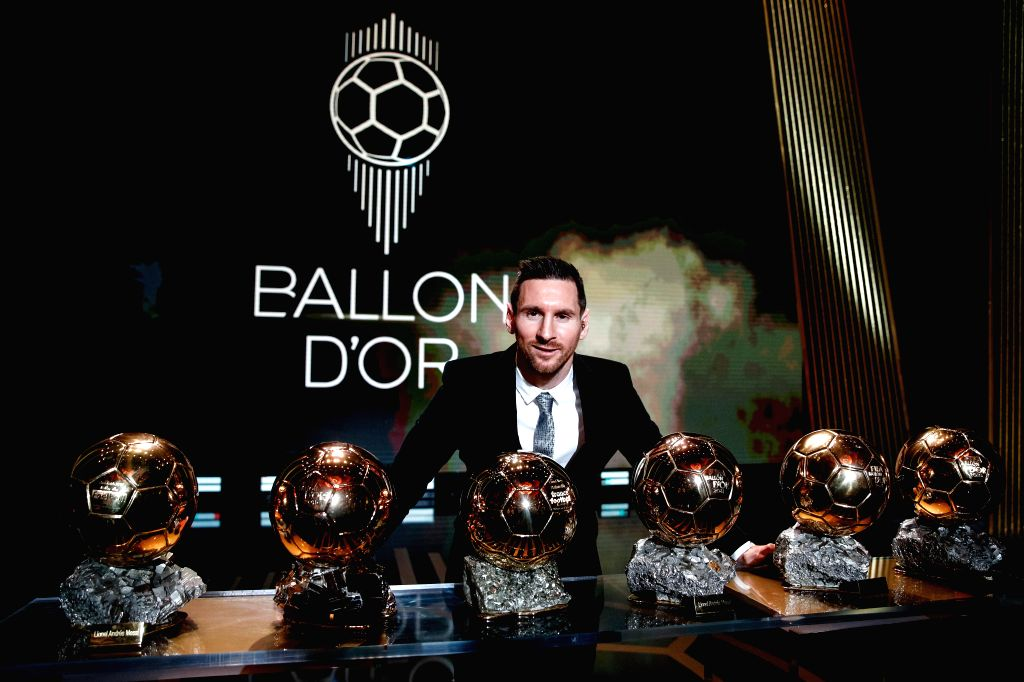 PARIS, Dec. 3, 2019 (Xinhua) -- Barcelona's Argentinian forward Lionel Messi poses with the trophies during the Ballon d'Or 2019 awards ceremony at the Theatre du Chatelet in Paris, France, Dec. 2, 2019. (Photo by Aurelien Morissard/Xinhua/IANS)