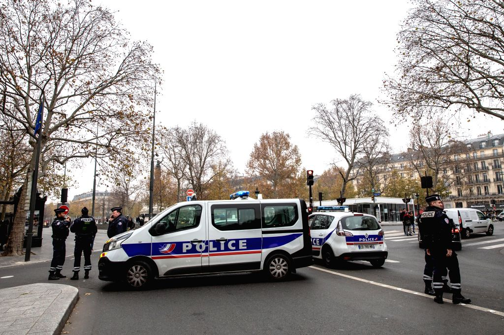 PARIS, Dec. 5, 2019 (Xinhua) -- Police stand guard during a strike in Paris, France, Dec. 5, 2019. Train and metro stations are deserted, schools closed and many aircrafts grounded across French cities on Thursday as the country's labor unions staged