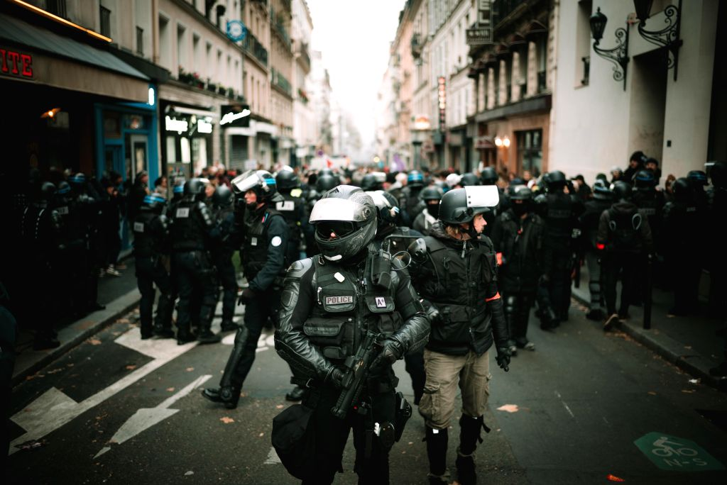 PARIS, Dec. 6, 2019 - Police officers stand guard during a demonstration in Paris, France, on Dec. 5, 2019. French Prime Minister Edouard Philippe on Friday justified a plan to overhaul pension ... - Edouard Philippe