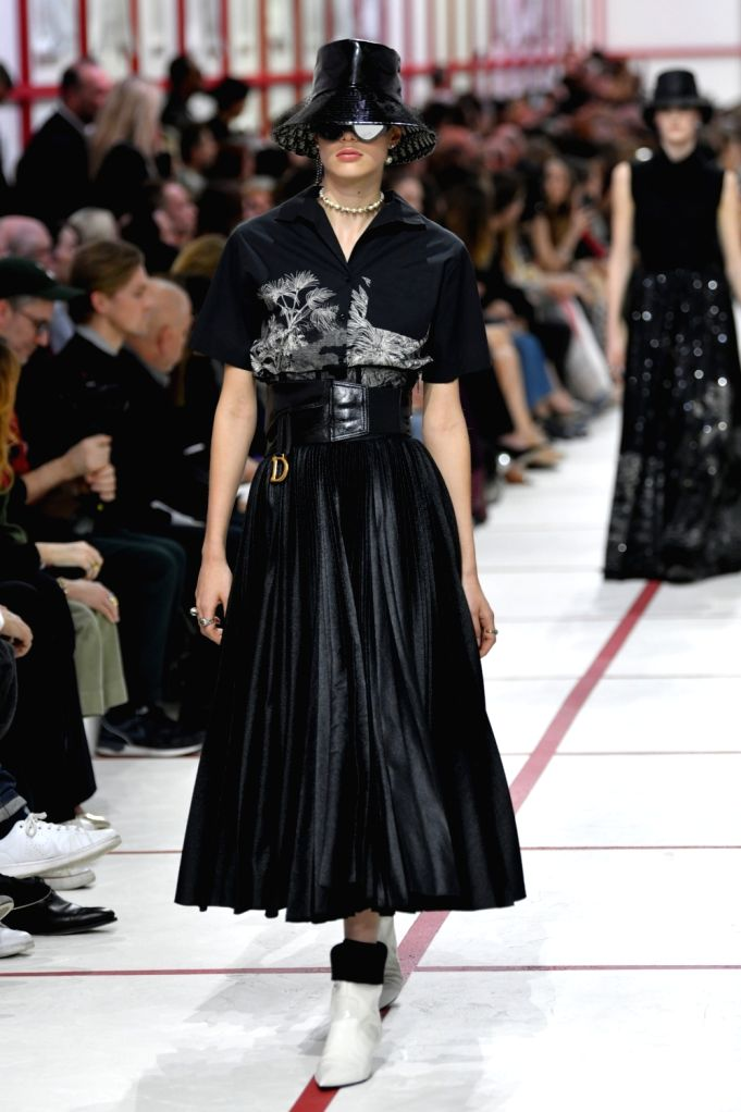 PARIS, Feb. 26, 2019 - A model presents a creation for Christian Dior Fall/Winter 2019/2020 ready-to-wear collection show during Paris fashion week in Paris, France, on Feb. 26, 2019.