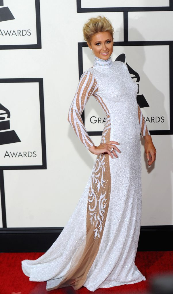 : Paris Hilton arrives on the red carpet for the 56th Grammy Awards at the Staples Center in Los Angeles, the United States, on Jan. 26, 2014. (Xinhua/Yang ...