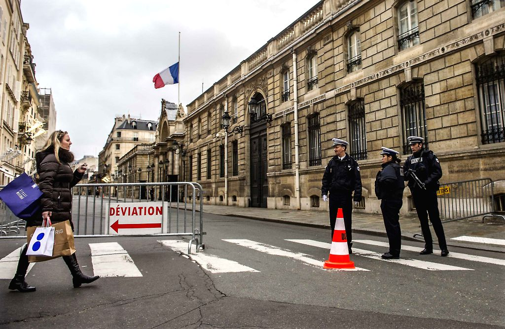 French police cordon off the road to the Elysee Palace in Paris, France on Jan. 10, 2015. France will maintain its national security alert system Vigipirate at the ...