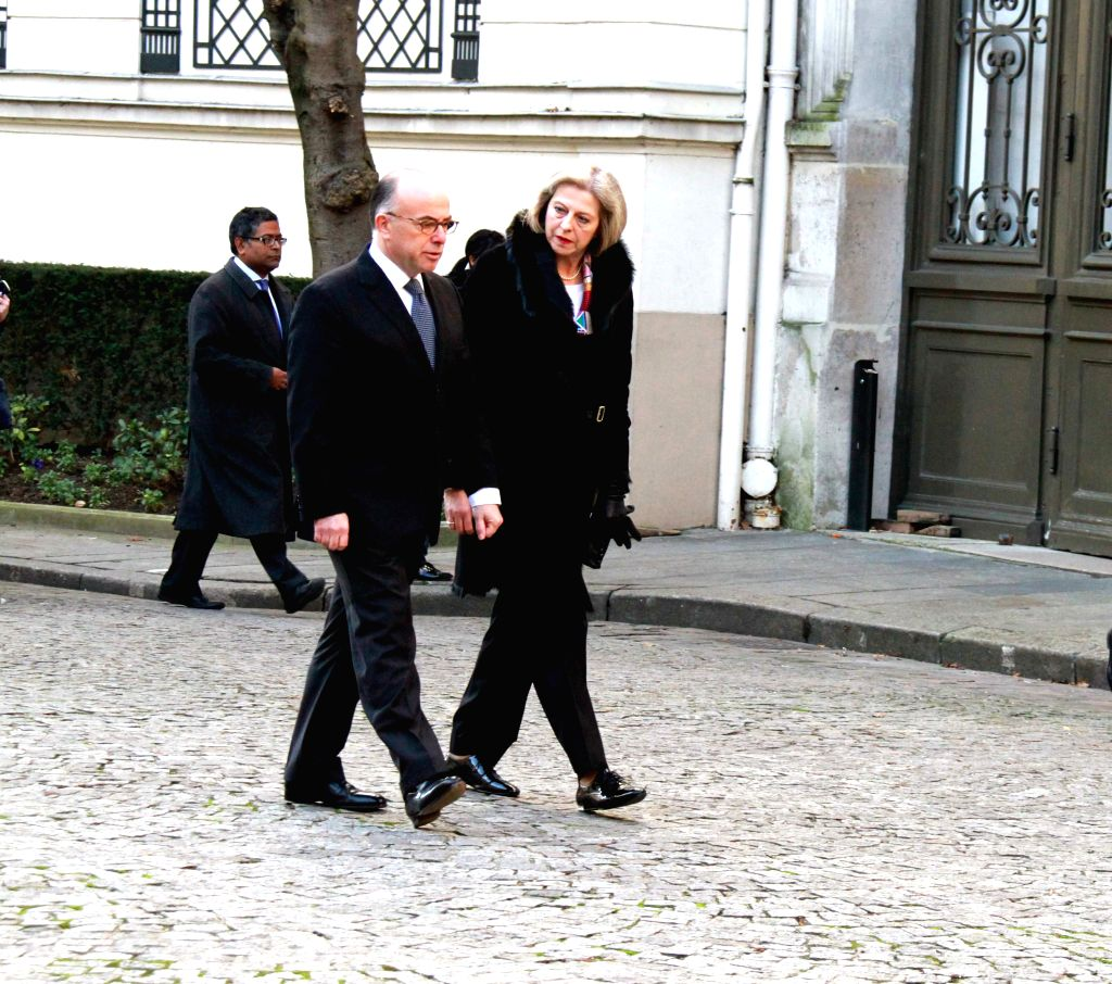 French Interior Minister Bernard Cazeneuve (L) welcomes British Home Secretary Theresa May in French Interior Ministry, in Paris, France, Jan. 11, 2015. A summit on .. - Bernard Cazeneuve
