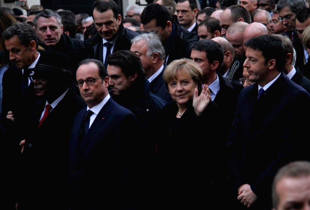 French President Francois Hollande (3rd R), German Chancellor Angela Merkel (2nd R) and Italian Prime Minister Matteo Renzi (1st R) take part in a march in Paris, ... - Matteo Renzi