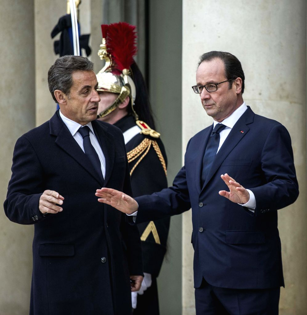 French President Francois Hollande (R) welcomes former French President Nicolas Sarkozy at the Elysee Palace in Paris, France, Jan. 11, 2015. A massive march ...