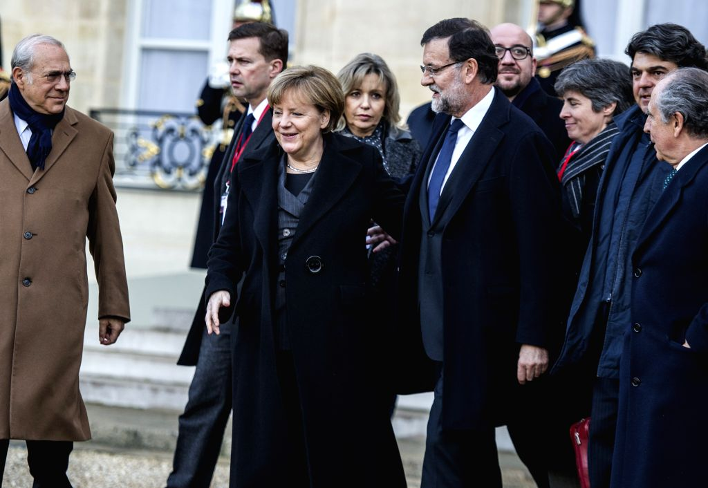Spanish Prime Minister Mariano Rajoy(5th L) and German Chancellor Angela Merkel(3rd L) set off for a march in Paris, France, Jan. 11, 2015. A massive march commenced . - Mariano Rajoy
