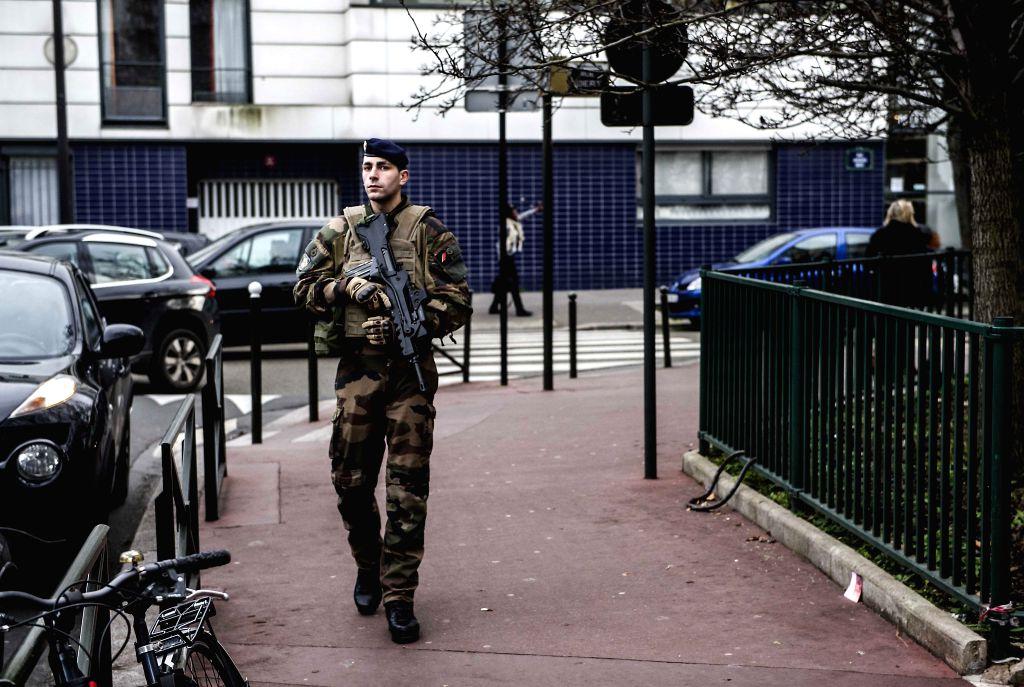 "A soldier patrols near a school run by Jews in Paris, France, Jan. 12, 2015. France's national security alert system ""Vigipirat"" has been set at the highest - Manuel Valls"