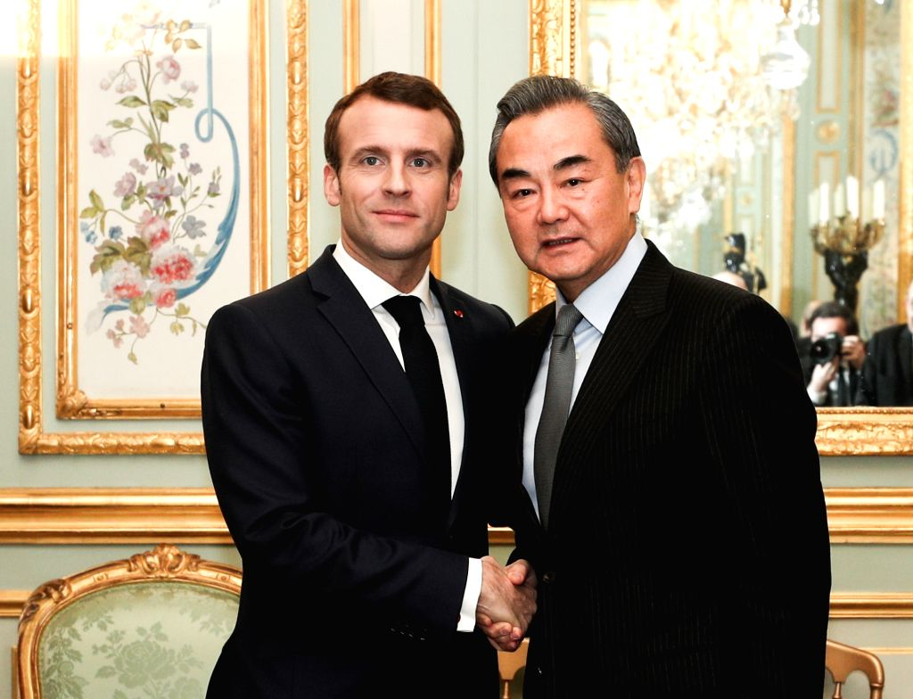 PARIS, Jan. 24, 2019 - French President Emmanuel Macron meets with Chinese State Councilor and Foreign Minister Wang Yi at the Elysee Palace in Paris Jan. 23, 2019. - Wang Y