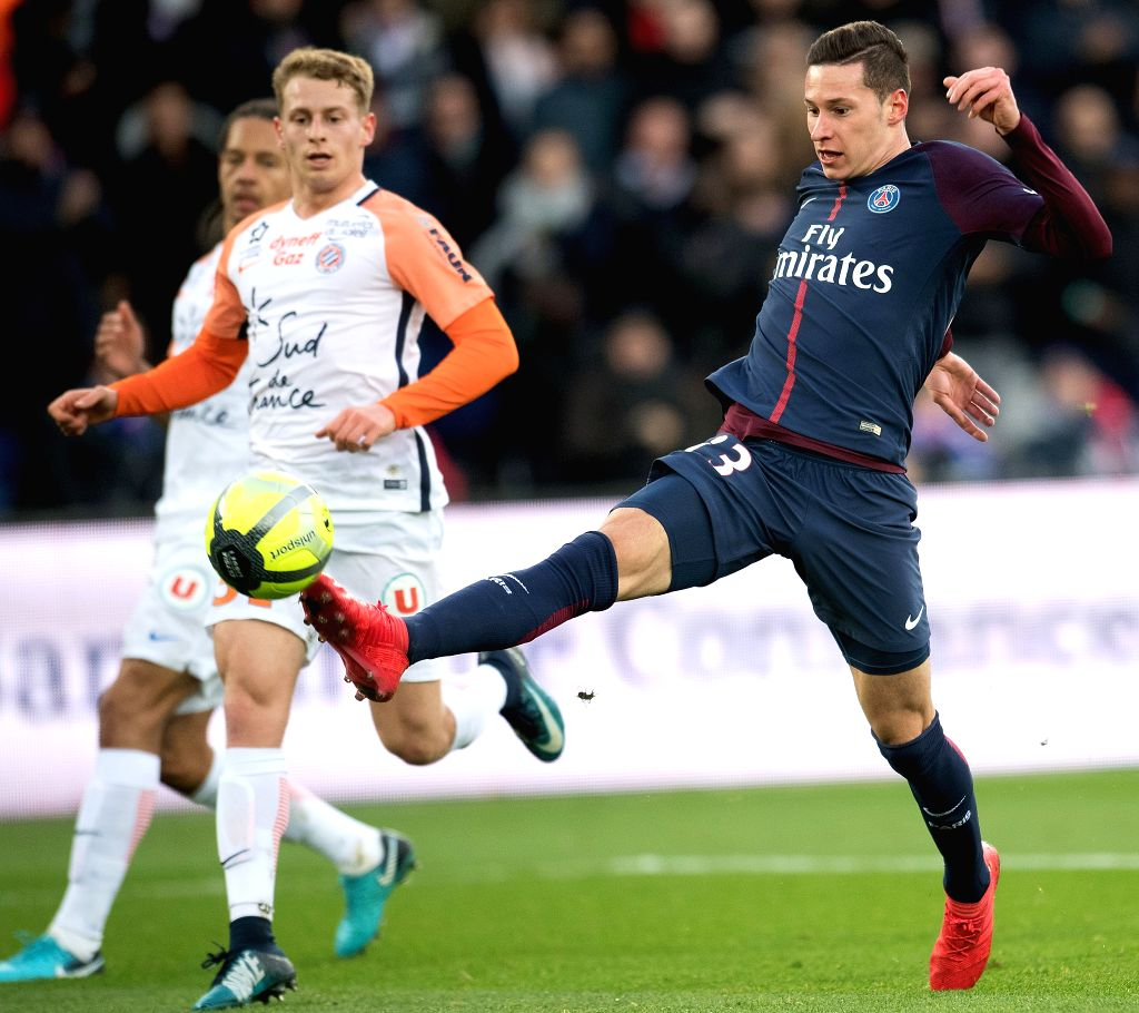 PARIS, Jan. 28, 2018 - Julian Draxler (R) of Paris Saint-Germain shoots during the French Ligue 1 match against Montpellier in Paris, France on Jan. 27, 2018. Paris Saint-Germain won 4-0.