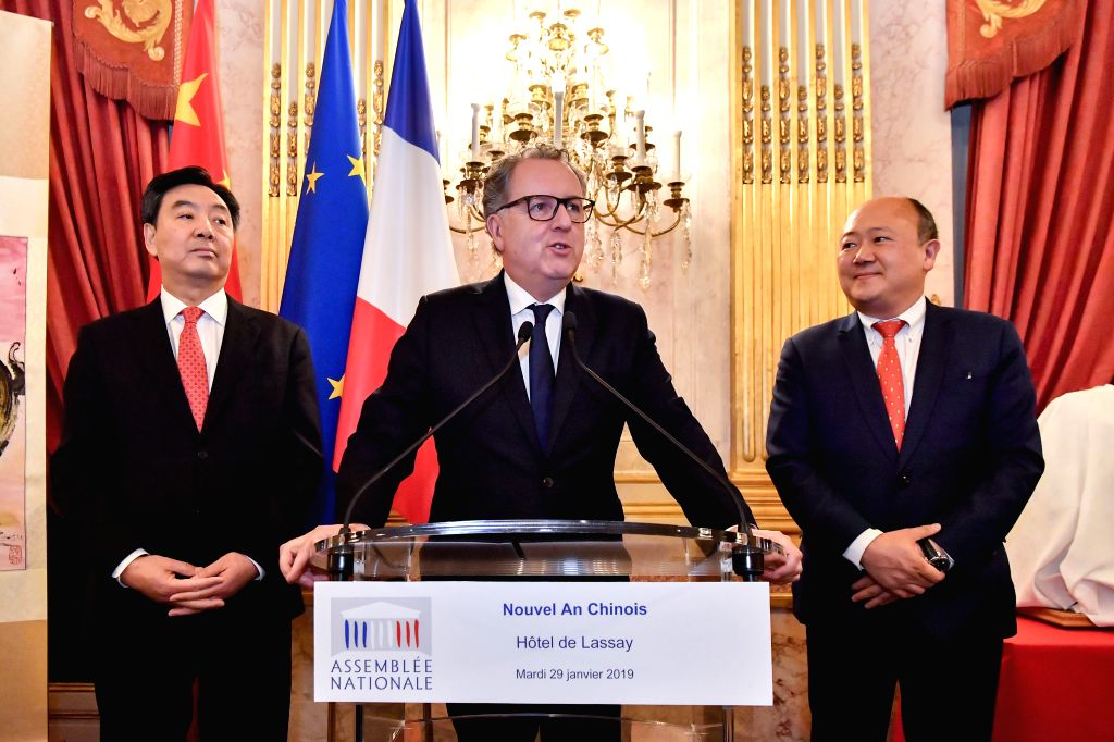 PARIS, Jan. 30, 2019 - Richard Ferrand (C), president of the National Assembly of France, speaks during a reception held to celebrate the upcoming Spring Festival, or the Chinese Lunar New Year, in ...