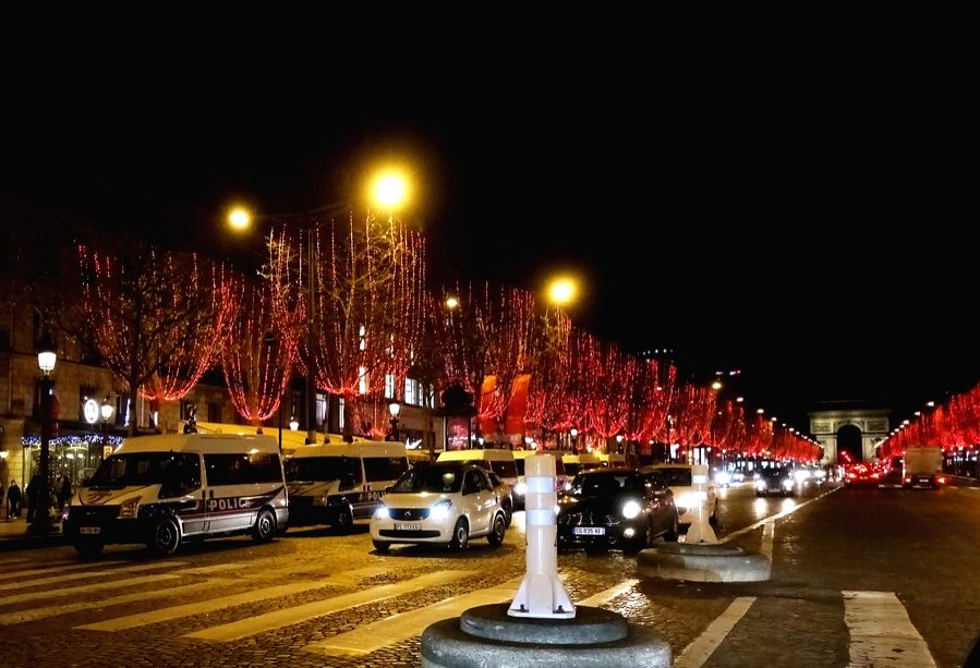 Paris, Jan. 4 Police cars gather in the Champs Elysees avenue for a curfew on New Year's Eve in Paris, Dec. 2020.