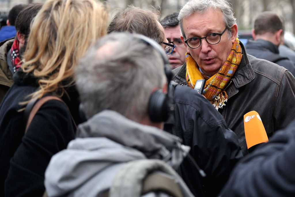 A witness (R) of the attack speaks to the media near the Paris office of Charlie Hebdo in Paris, France, Jan. 7, 2015. The office of Paris Prosecutor of the Republic ..