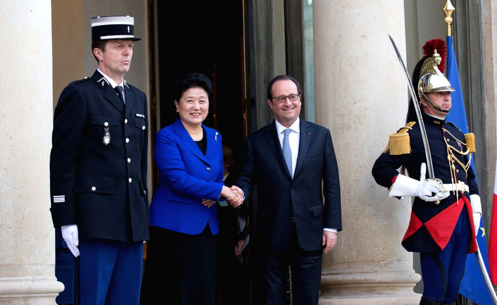 PARIS, July 1, 2016 - Visiting Chinese Vice Premier Liu Yandong (2nd L) shakes hands with French President Francois Hollande (2nd R) in Paris, France, June 30, 2016. (Xinhua/Xu JinquanVIENNA, July 1, ...