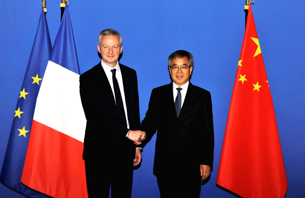 PARIS, July 11, 2018 - Visiting Chinese Vice Premier Hu Chunhua (R) holds talks with French Finance Minister Bruno Le Maire in Paris, France, July 9, 2018. - Bruno L