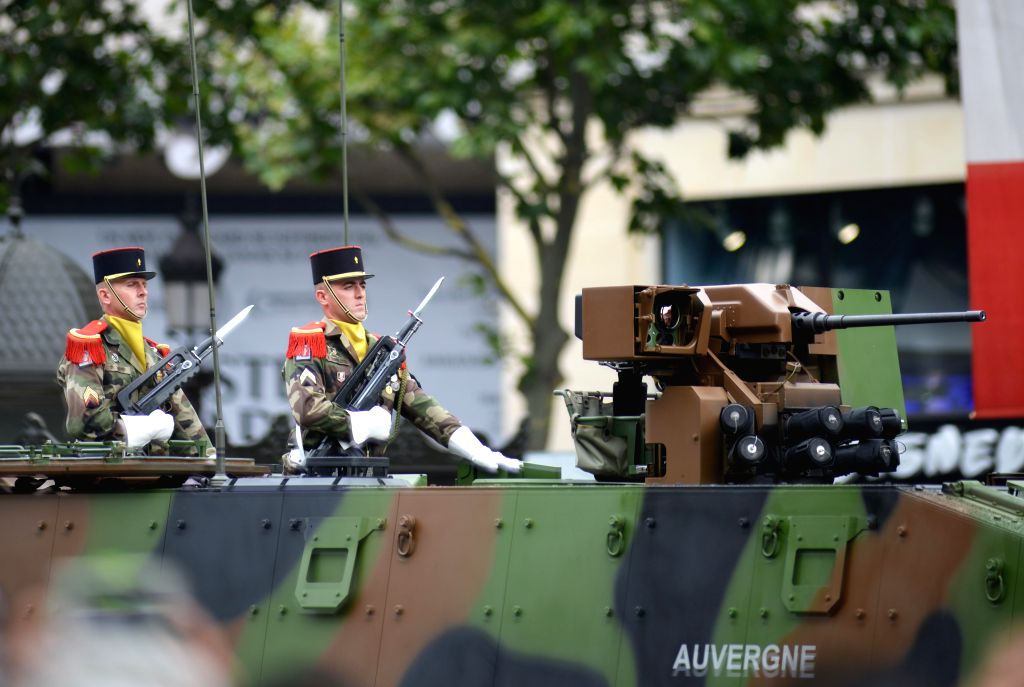 Soldiers of the tank regiment participate in the annual Bastille Day military parade on the Champs Elysees Avenue in Paris, France, on July 14, 2014. France ...