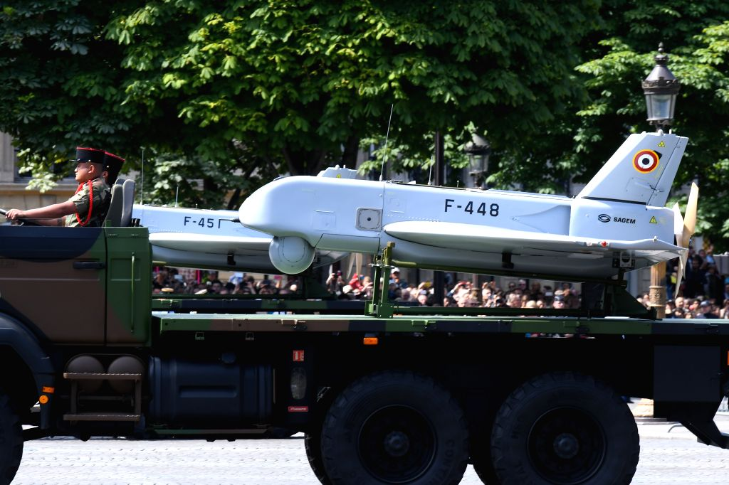 PARIS, July 14, 2016 - French soldiers drive a truck carrying the Sperwer tactical drone as they parade during the annual Bastille Day military parade in Paris, France, July 14, 2016.