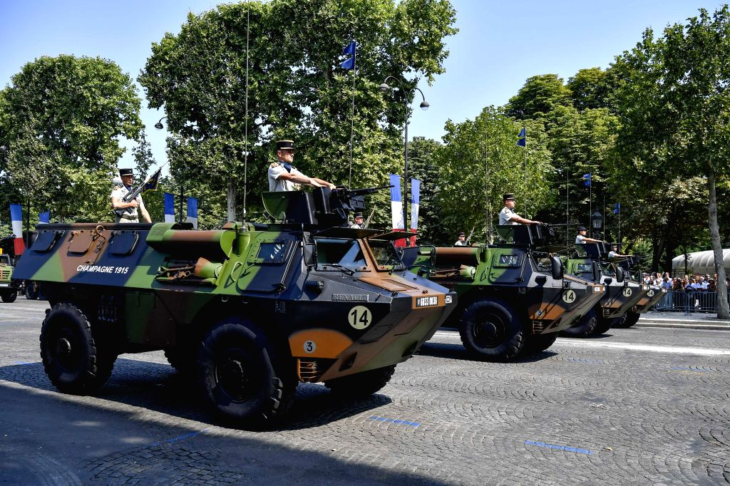 PARIS, July 14, 2018 - Military vehicles pass the Champs-Elysees Avenue during the annual Bastille Day military parade in Paris, France, on July 14, 2018.