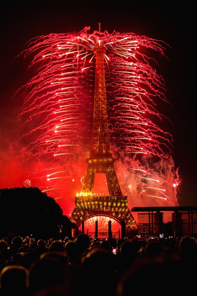Fireworks explode around the Eiffel Tower during the Bastille Day celebrations in Paris, capital of France, July 14, 2014.