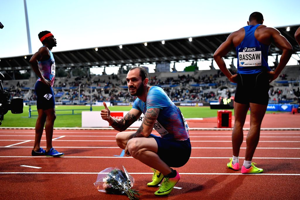 PARIS, July 2, 2017 - Ramil Guliyev (C) of Turkey gestures after the men's 200m final of the IAAF Diamond League athletics meeting in Paris, France on July 1, 2017. Ramil Guliyev claimed the title ...