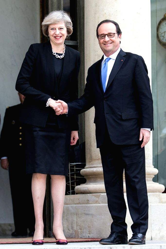 PARIS, July 21, 2016 - French President Francois Hollande(R) shakes hands with British Prime Minister Theresa May during their meeting at the Elysee Palace in Paris, France on July 21, 2016. French ... - Theresa May
