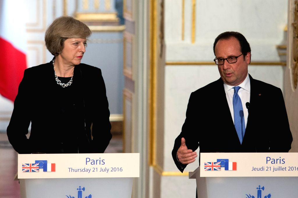 PARIS, July 21, 2016 - French President Francois Hollande(R) and British Prime Minister Theresa May attend a press conference after their meeting at the Elysee Palace in Paris, France on July 21, ... - Theresa May