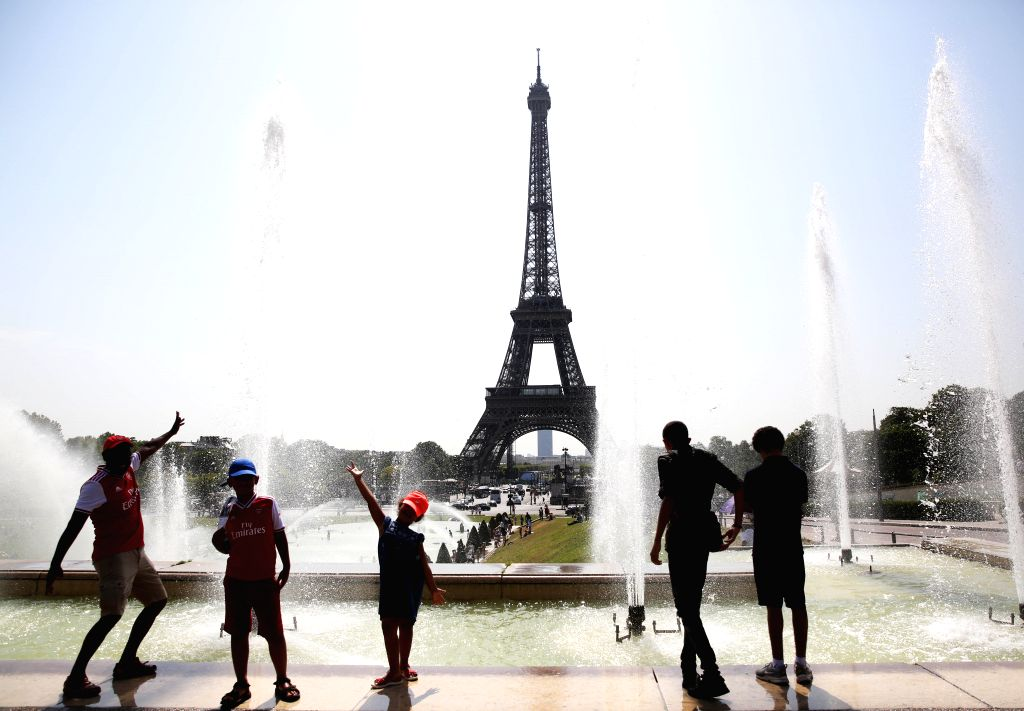PARIS, July 25, 2019 - People pose by a fountain at the Trocadero Place in Paris, France, July 25, 2019. Temperature in Paris hit 42 degrees centigrade on Thursday.