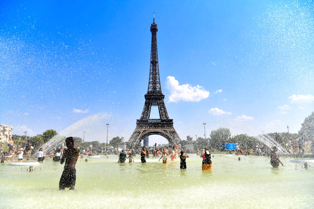 PARIS, July 26, 2019 - People cool themselves at a fountain near the Eiffel Tower in Paris, France, July 25, 2019. Thursday is the hottest day of the intense heatwave episode in France's northern ...