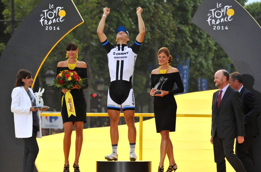 The final stage winner Team Giant-Shimano Marcel Kittel (C) of Germany celebrates during the awarding ceremony after the 137.5 km final stage of the 2014 Tour de ...