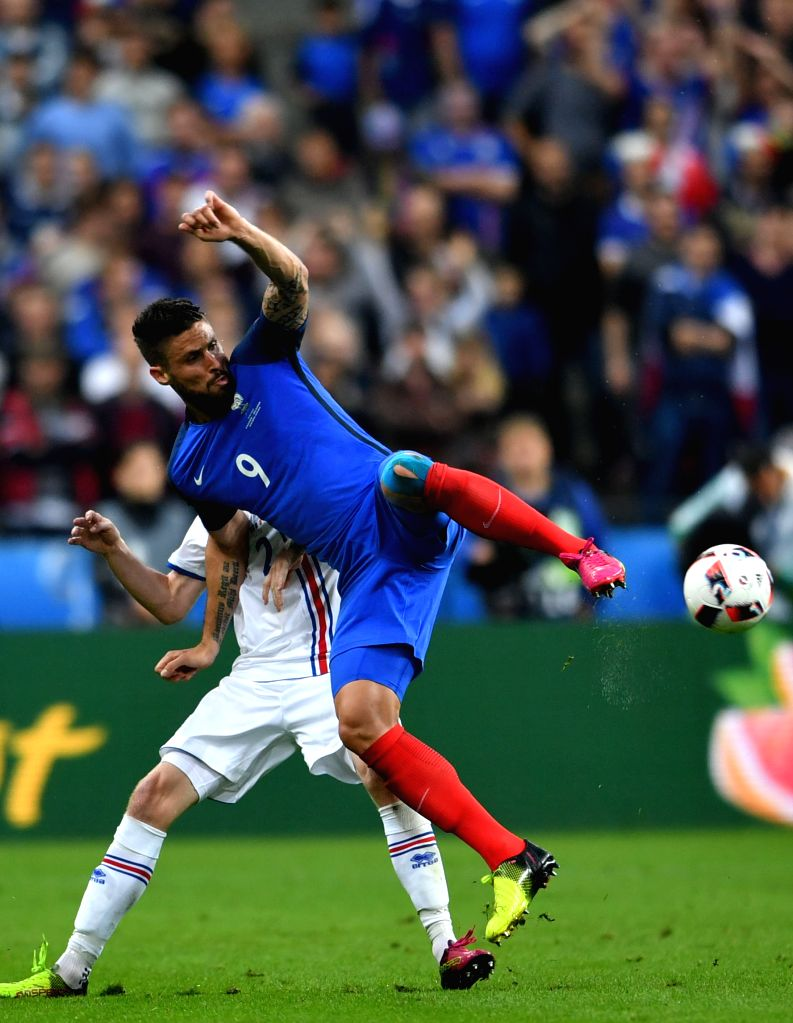 PARIS, July 4, 2016 - Olivier Giroud(R) of France competes during the Euro 2016 quarterfinal match between France and Iceland in Paris, France, July 3, 2016.