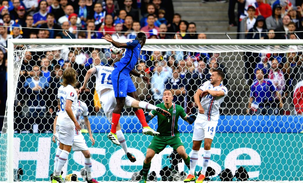 PARIS, July 4, 2016 - Paul Pogba(C) of France heads to score during the Euro 2016 quarterfinal match between France and Iceland in Paris, France, July 3, 2016.