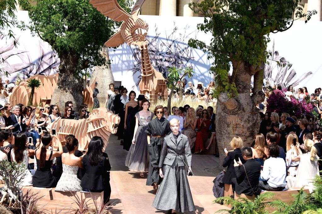PARIS, July 4, 2017 - Models present creations of Christian Dior during the Haute Couture 2017/18 Fall/Winter  collection shows in Paris, France, on July 3, 2017. (Xinhua/Piero Biasion)