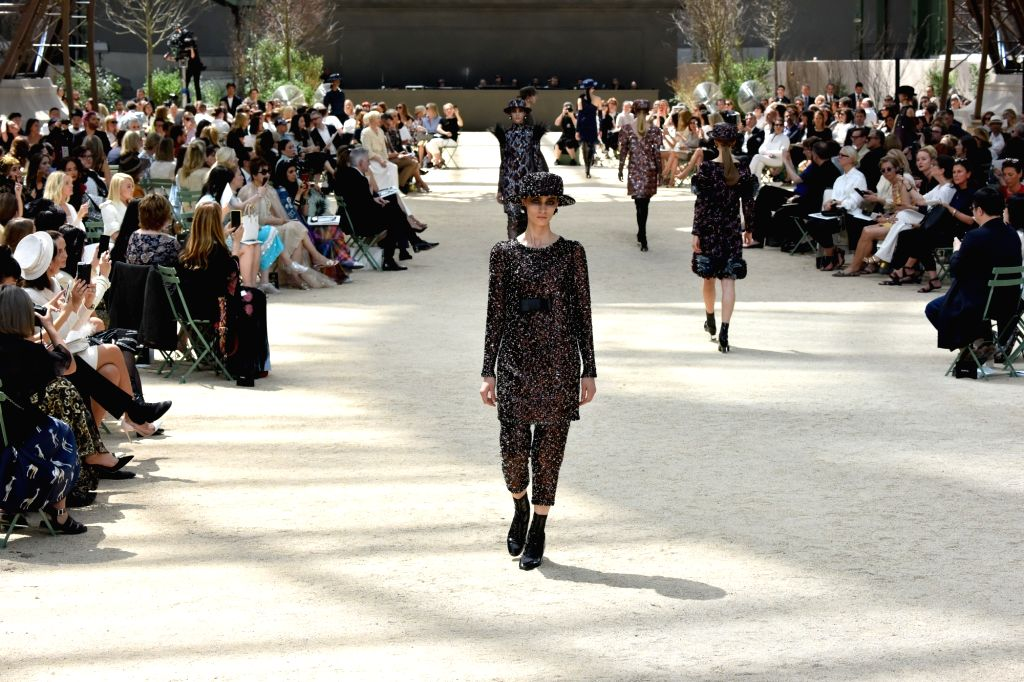 PARIS, July 4, 2017 - Models present creations of Chanel during the Haute Couture 2017/18 Fall/Winter collection shows in Paris, France, on July 4, 2017.