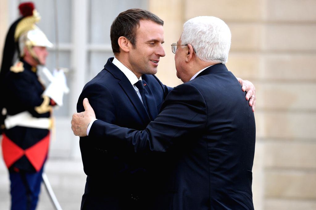 PARIS, July 5, 2017 - French President Emmanuel Macron (L, Front) welcomes Palestinian President Mahmoud Abbas at the Elysee Palace in Paris, France, on July 5, 2017.