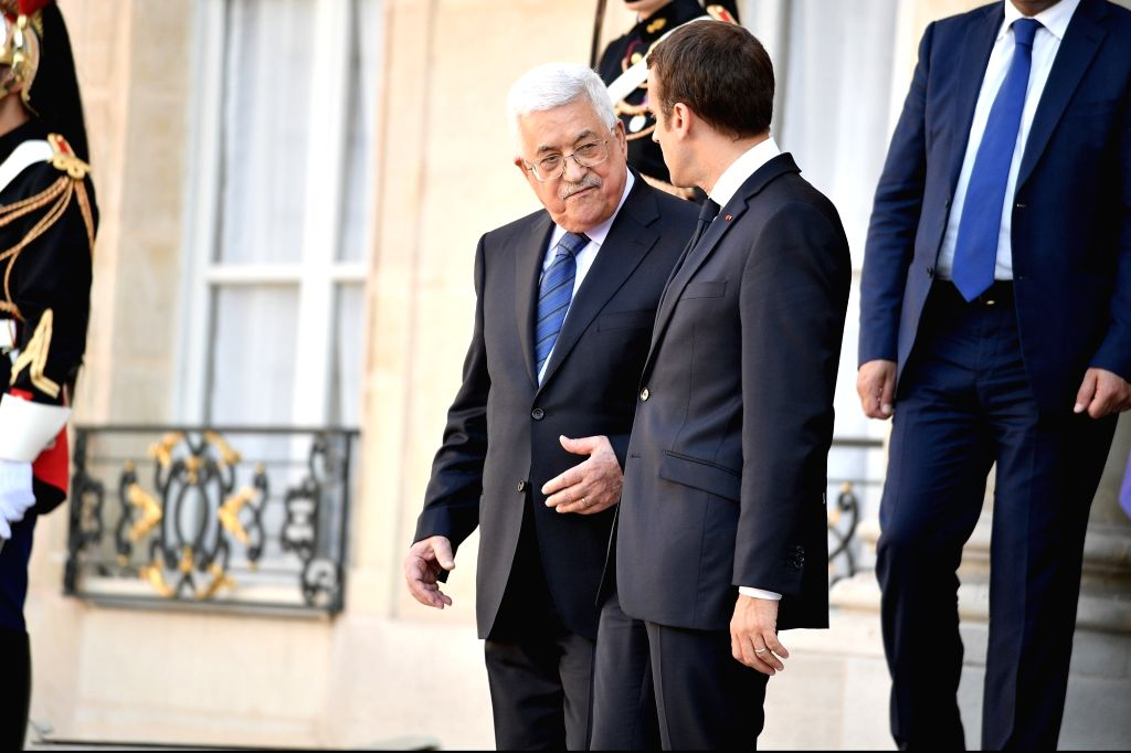 PARIS, July 5, 2017 - French President Emmanuel Macron (R, Front) talks with Palestinian President Mahmoud Abbas during their meeting at the Elysee Palace in Paris, France, on July 5, 2017.