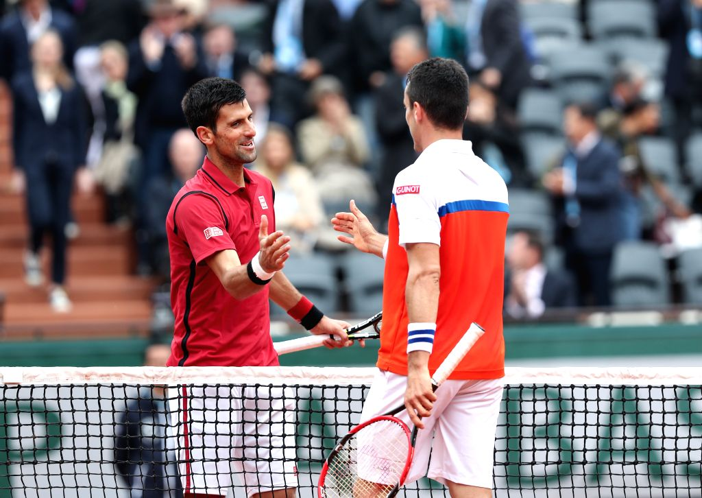 PARIS, June 1, 2016 - Novak Djokovic (L) of Serbia shakes hands with Roberto Bautista Agut of Spain after the men's singles fourth round match on day 11 of 2016 French Open tennis tournament at ...