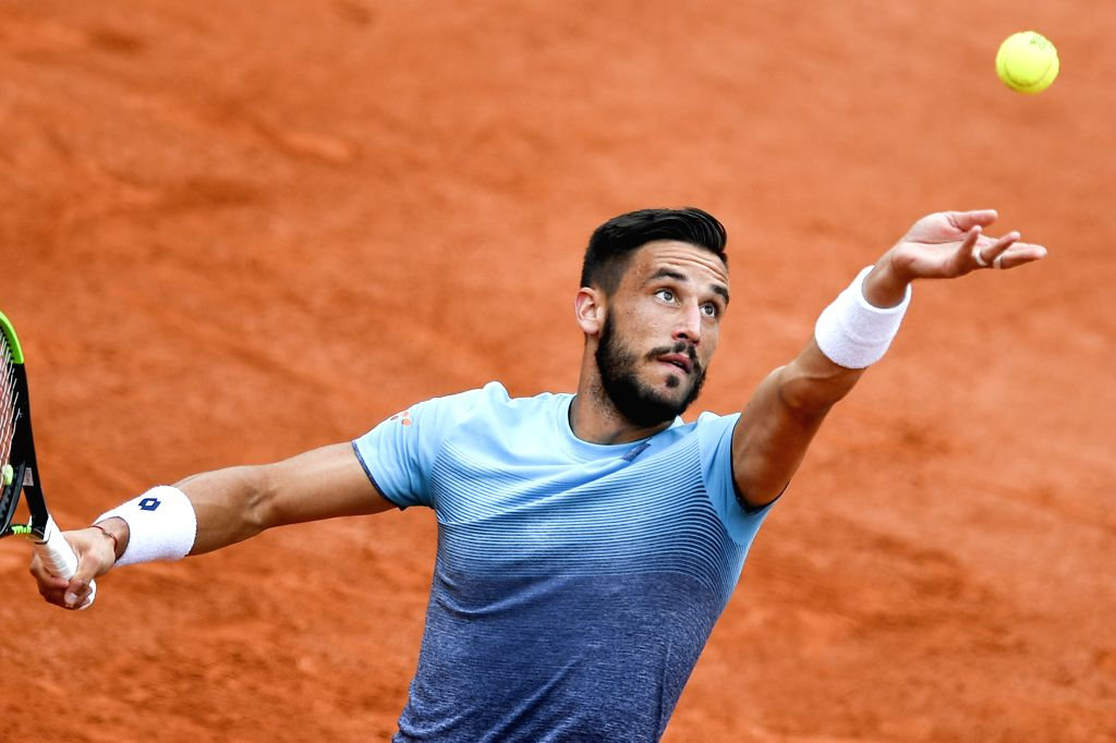 PARIS, June 1, 2018 - Damir Dzumhur of Bosnia and Herzegovina serves during the men's singles third round match against Alexander Zverev of Germany at the French Open Tennis Tournament 2018 in Paris, ...
